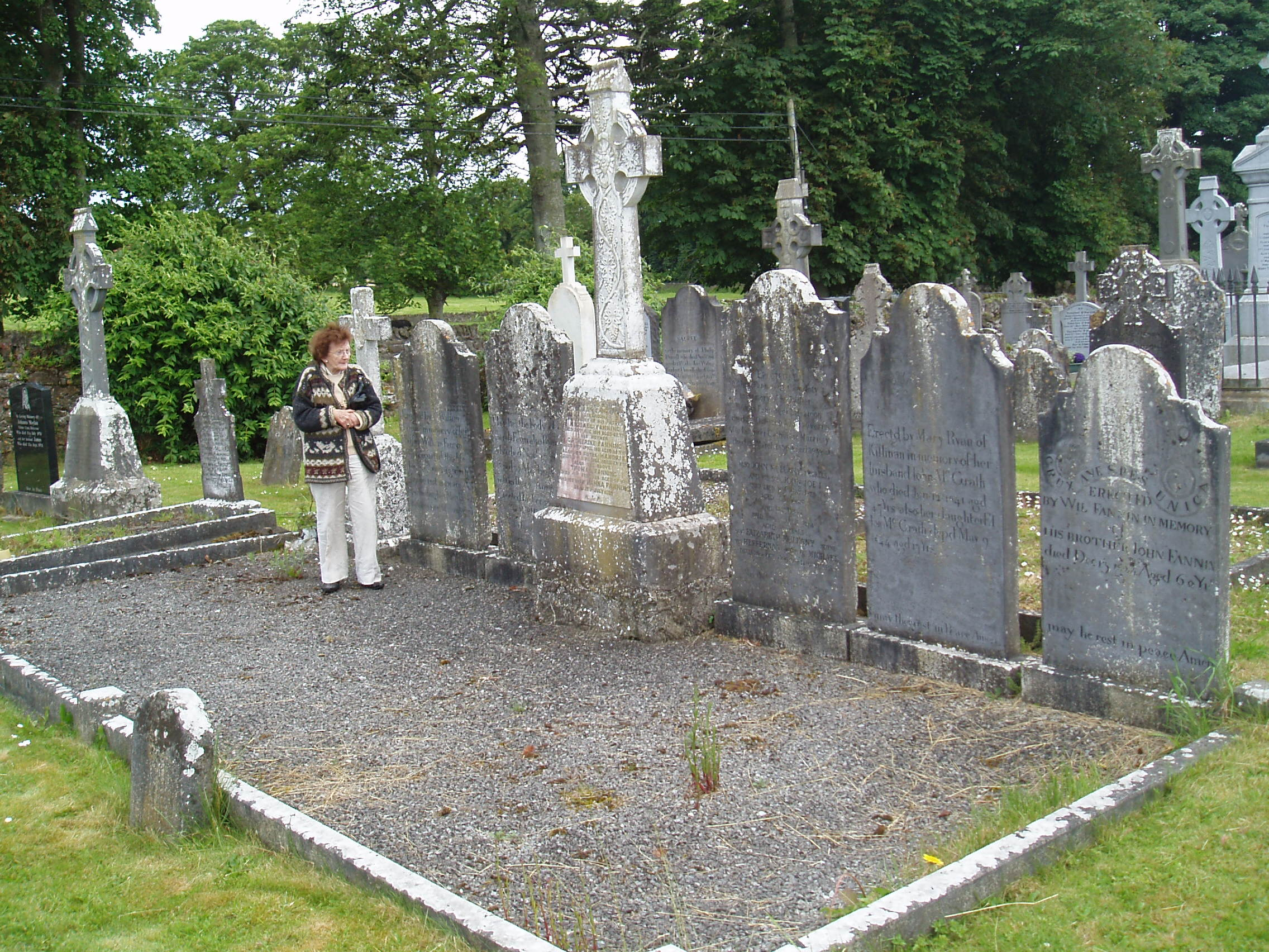 Delia Cullen nee Mullany in front of the Fanning Family Graves at Ballycahill Cemetery Co Tipperary Ireland June 2011